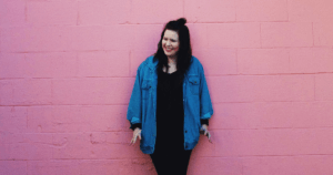 The Three Breaths Rule | Image of woman in front of pink brick wall